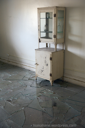 antique medicine cabinet, floor of broken glass
